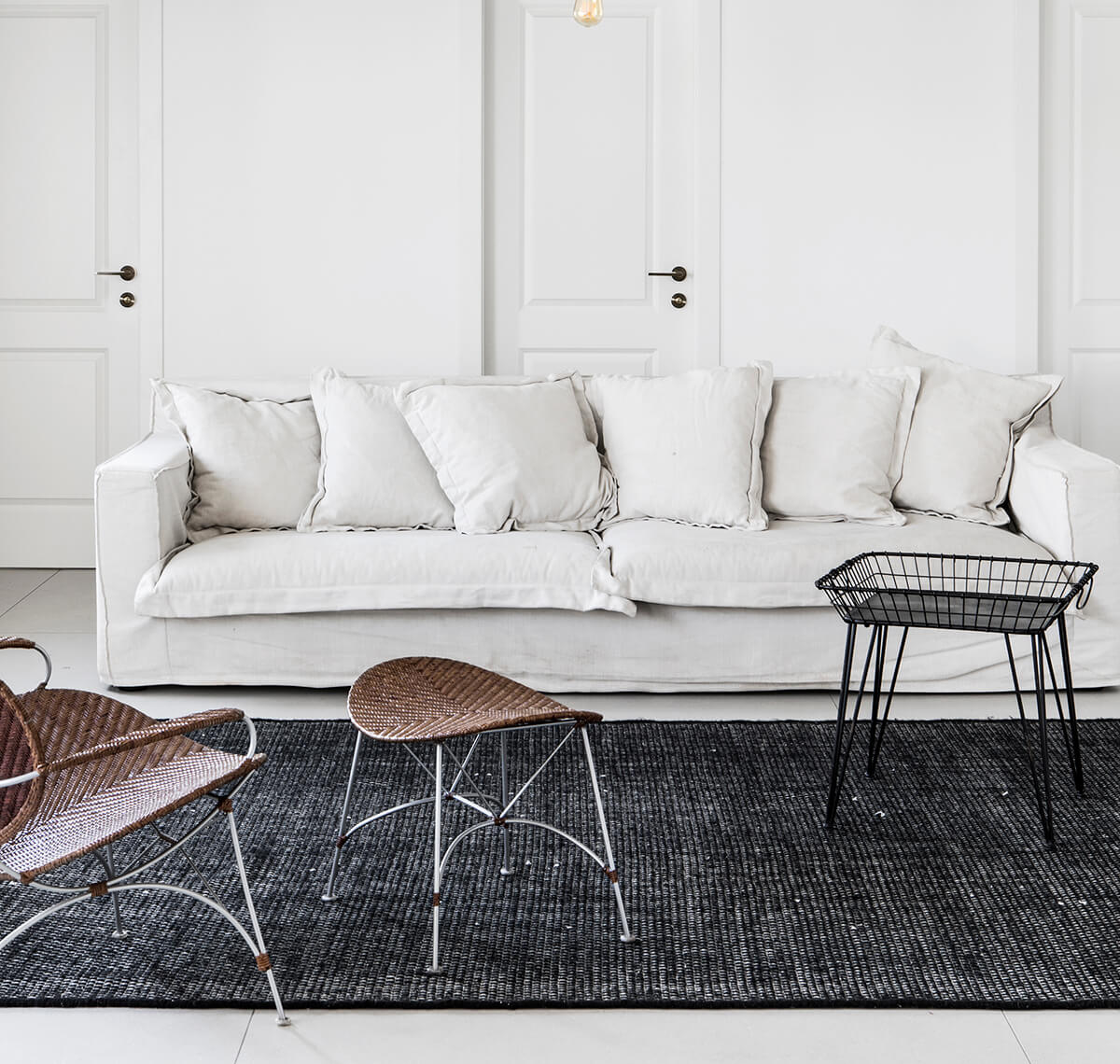 White sofa in nordic apartment designed by Roni Bartal