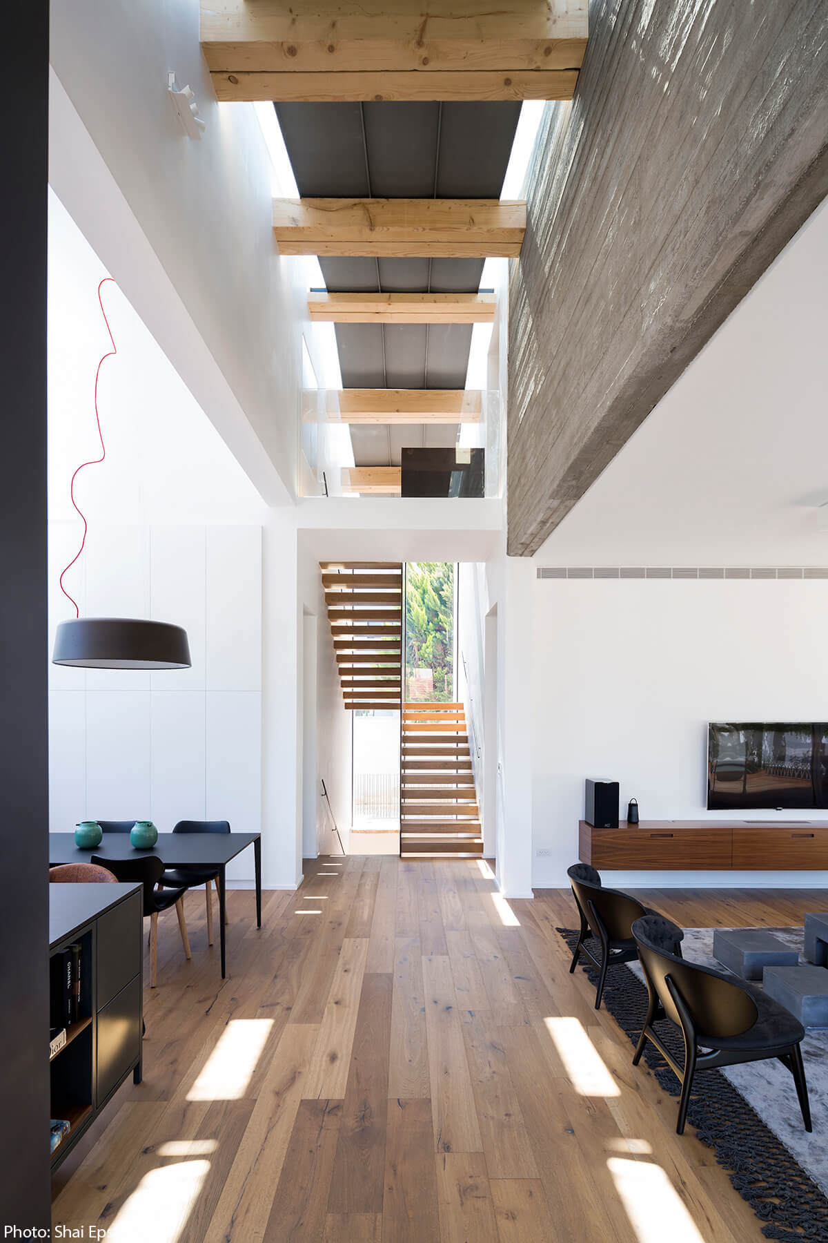 Wooden stairs in 320sqm House designed by archiFETO - Fineshmaker