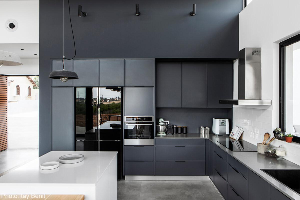 Gray kitchen in 180sqm House designed by Carmit Gat - Fineshmaker