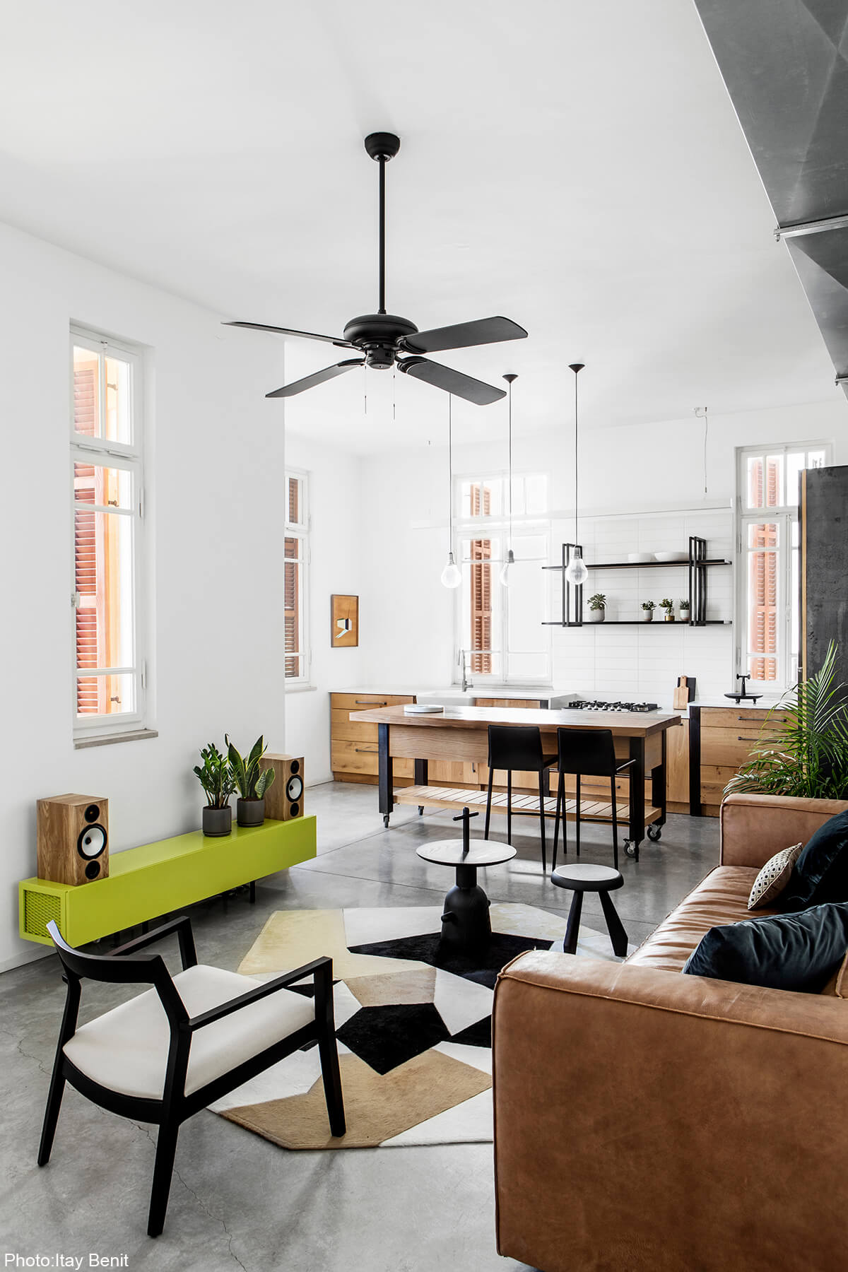 Interior design of modern apartment in an old preserved building next to the Carmel market. In the most hectic area in Tel Aviv this home was meant to serve as a serene haven. Clean lines, concrete floors and bare materials compliment the high ceiling and large wooden windows of the historic building, designed by Adi Mor Architect - Fineshmaker