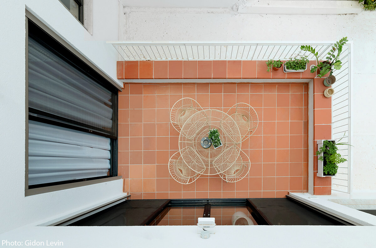 The owner passion for the mediterranean style is reflected in the Terracotta tiles. The Terracotta cover most of the inner and outer floors, as well as the staircase which leads to the upper floor - Interior design by Jonathan Canetti Architecture & Design