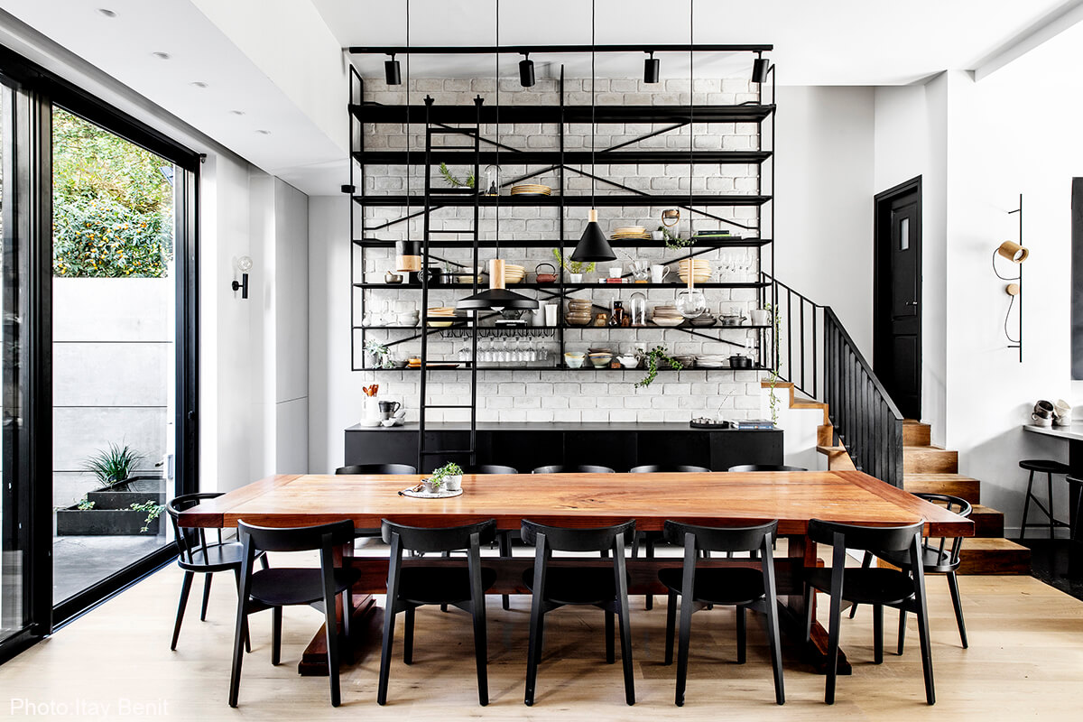 Dining Room with a library made of black iron